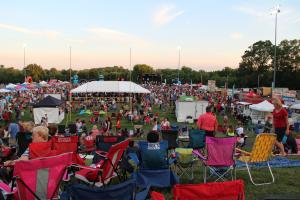 Image of crowd in lawn chairs sitting outside